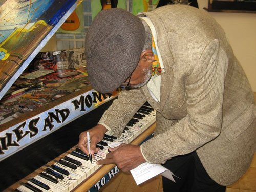 Amiri Baraka signs piano key